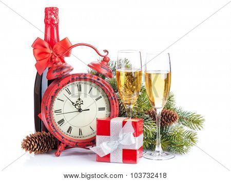 Champagne, christmas gift, clock and fir tree. Isolated on white background