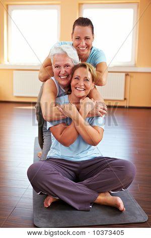 Women Sitting In Gym