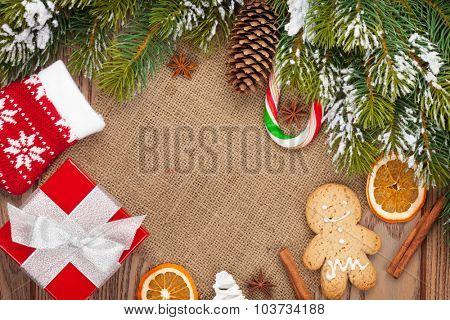 Christmas food, decor and gift box with snow fir tree background with copy space