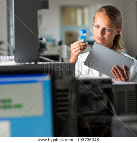 Portrait of a female researcher doing research in a lab (shallow DOF; color toned image)