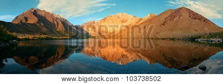 Snow mountain and lake with reflections panorama in Yosemite.