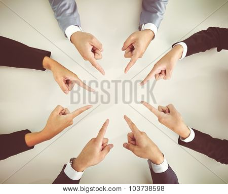 Hands of business people pointing at each other