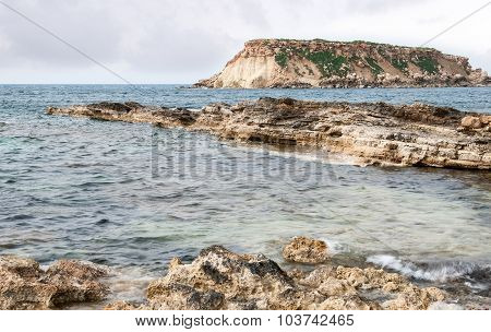 Rocky Seascape With The Island Of  Geronisos