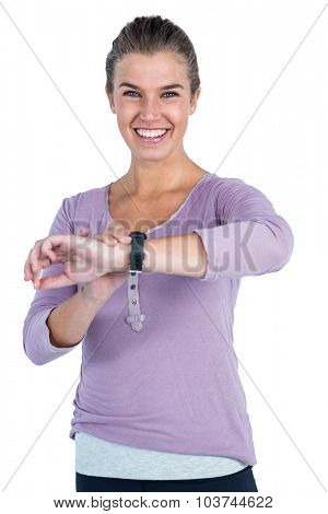 Portrait of happy young woman wearing wristwatch against white background