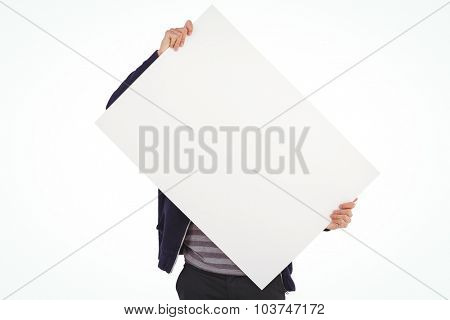 Man holding billboard in front of face against white background