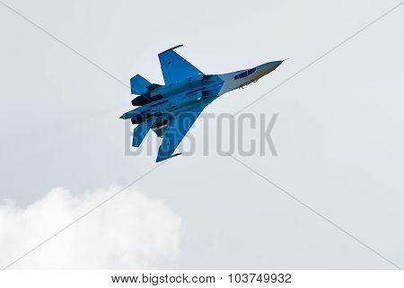 Russian fighter SU-27 flies upside down