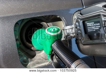 Closeup Pumping Gasoline Fuel In Passenger Car At Gas Station