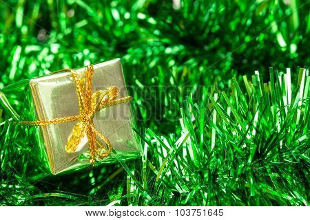 Green Tinsel And Little Gift Box