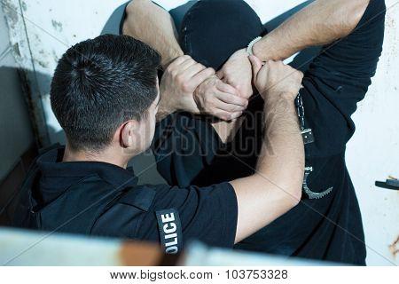 Putting Handcuffs On A Criminal