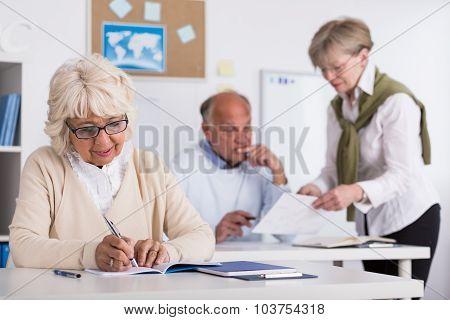 Teacher Helping Senior Man