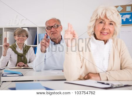 Retired People Raising Hands