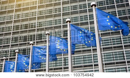 European Union flags in front of the Berlaymont building (European commission) in Brussels, Belgium. Header for website