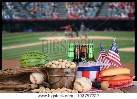 A big screen TV with a baseball game. In front of the television is a spread of snack food, beer and sports equipment. Great for Playoff or World Series themed projects. TV is out of focus.