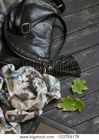 Women's Accessories - Leather Black Bag, Neckerchief And Tablet On Dark Wooden Surface
