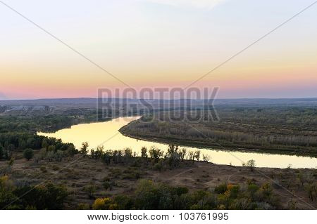 Chalk Mountains And River At Sunset.