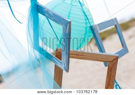 Summer beach decoration: photo frame with organza or silk on sea background