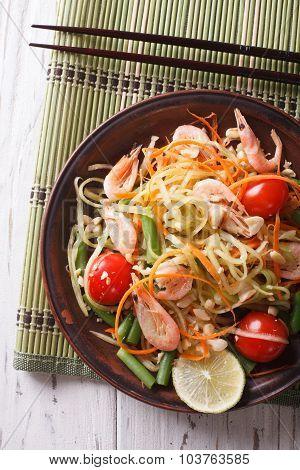 Thai Green Papaya Salad With Shrimp Close-up. Vertical Top View