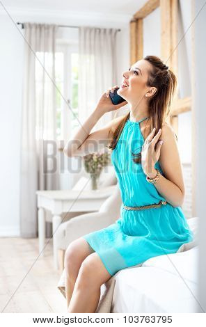 Young woman talking over a cellphone