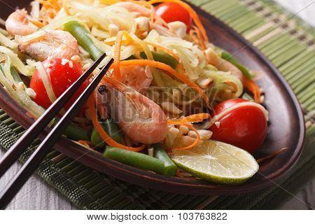 Papaya Salad Som Tam With Shrimp On A Plate. Macro, Horizontal