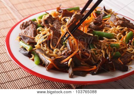 Lo Mein Noodles With Beef And Black Fungus Macro On A Plate. Horizontal