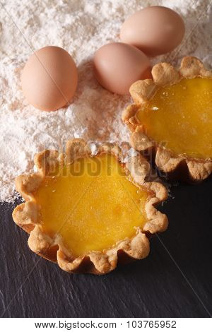 Traditional Egg Tart And Ingredients Close-up. Vertical