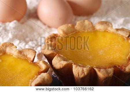 Egg Tart And Ingredients On The Table Macro. Horizontal