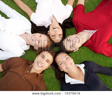 Friends Happy Group In Circle Together On Grass