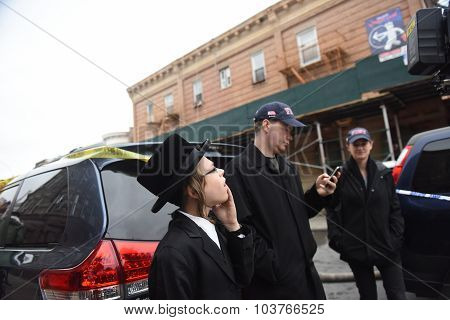 Hasidic boy watches scene