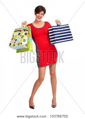 Happy mature shopping woman with bags isolated white background.