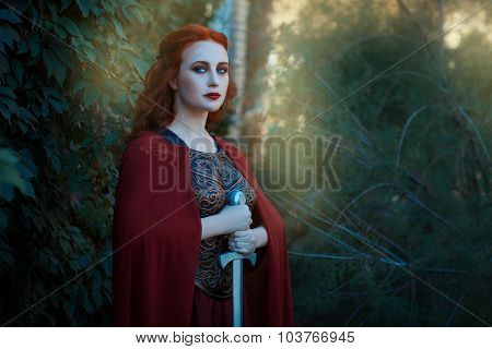 Portrait Of A Girl Female Warrior With Sword In Hand.