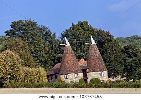 Old traditional Kentish round stone oast house