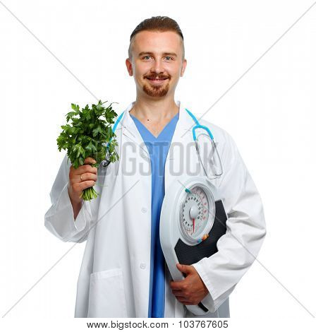 Medical doctor nutritionist with body scales and parsley. Weight loss.