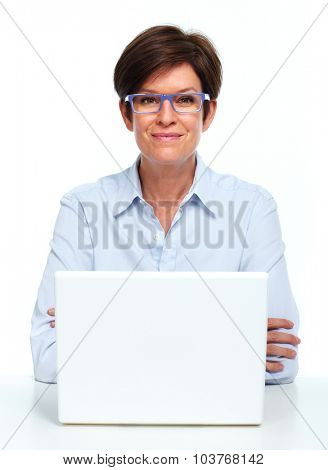 Mature smiling Business lady working with laptop computer.