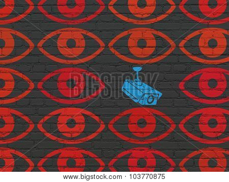 Protection concept: cctv camera icon on wall background