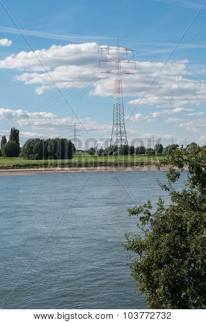 River Rhine With Blue Sky And Clouds, Power Lines And Power Plant