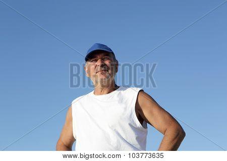 Senior Man On The Sky Background