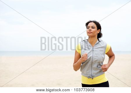 Young African American Woman Jogging By The Beach