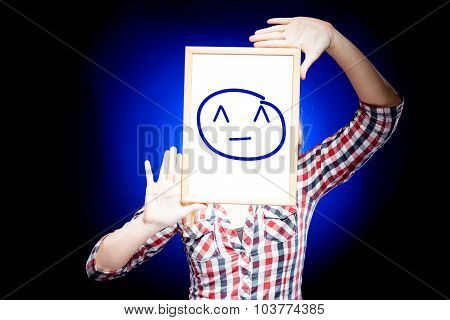 Woman Showing Grin Emoticon In Front Of Face