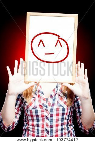 Woman Showing Kiki Emoticon In Front Of Face