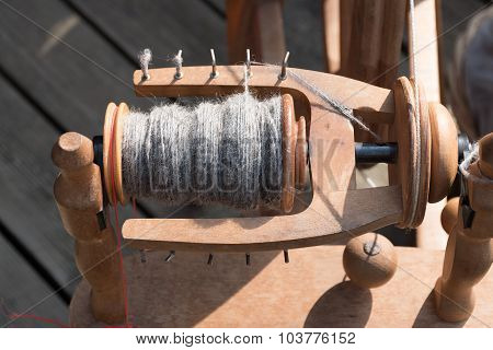 Spindle And Wool, Detail Of A Traditional Spinning Wheel