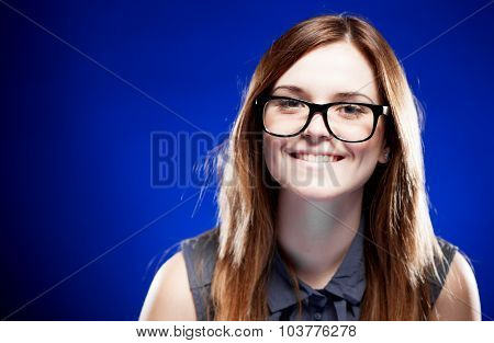 Young Woman With Lovely Smile And Nerd Glasses