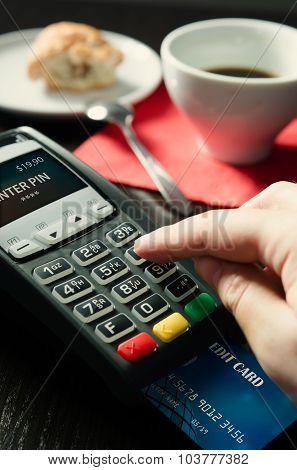 Man Making Payment With Terminal For Sale In Cafeteria