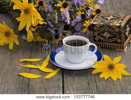 Cup Of Coffee, Casket, Flower, Petals And Wild Flowers On An Old Table, A Still Life, A Festive Card