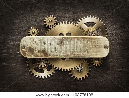 Clockwork mechanism background made of metal gears and brass plate.