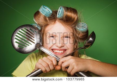 Little Girl Housewife .holding Kitchenware
