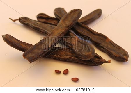 Carob pods dry with seeds