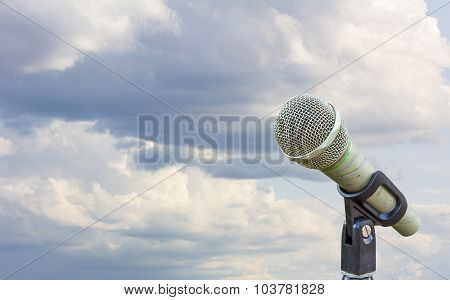 Microphone On A Stand With Blurred Gray Big Cloud In Blue Sky Before Raining In The Morning, Copyspa