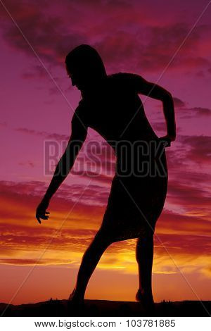 Silhouette Of A Woman In Tight Dress Lean To Side