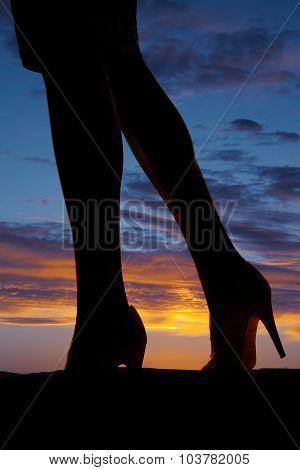Silhouette Of  Womans Legs Side Walk