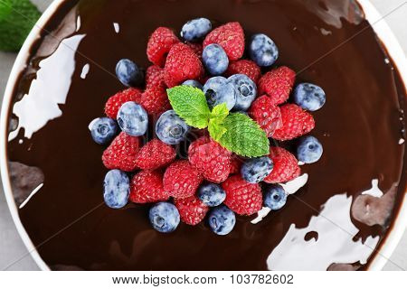 Delicious chocolate cake with summer berries, top view